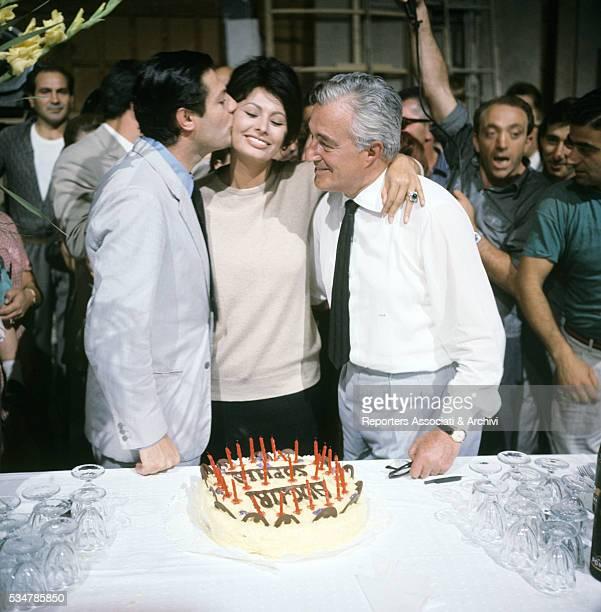 Italian actress Sophia Loren celebrating her birthday with Italian director Vittorio De Sica and Italian actor Marcello Mastroianni on the set of the...