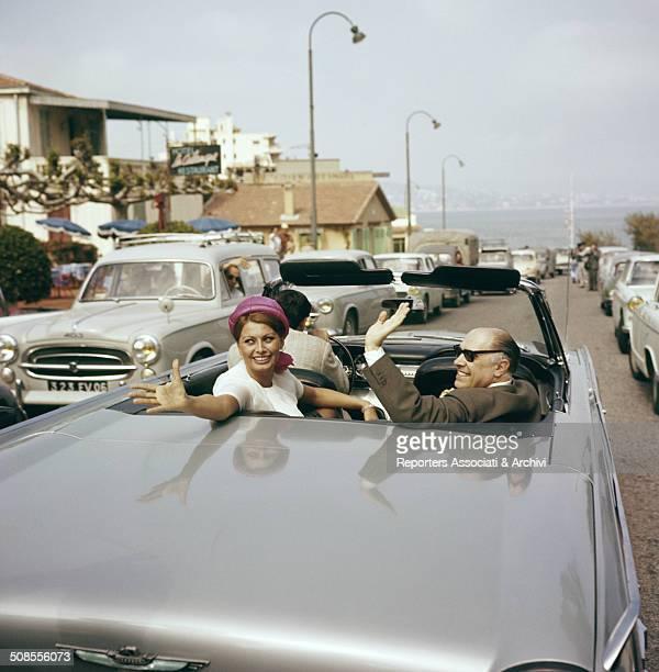 Italian actress Sophia Loren in a car with her husband producer Carlo Ponti 1960
