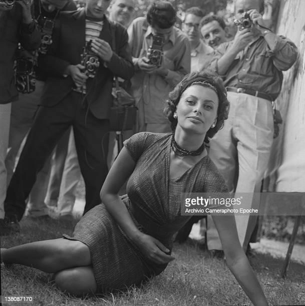 Italian actress Sophia Loren lying on the grass during a shooting Lido Venice 1958