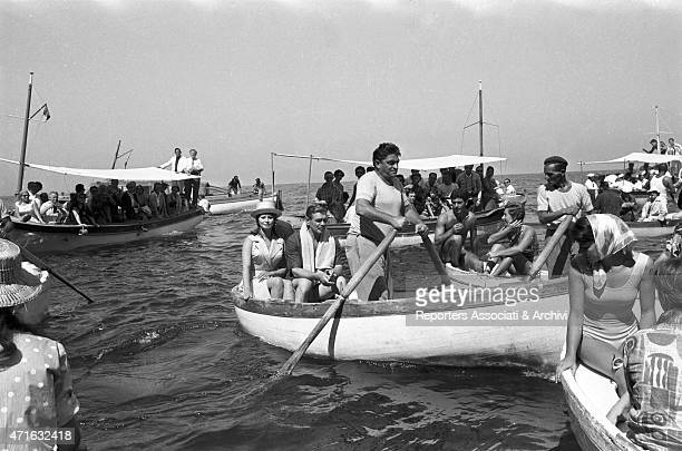 Italian actress Sophia Loren on a boat with American actor Clark Gable on the set of the film It Started in Naples 1959