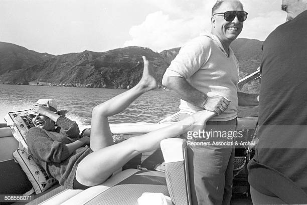 Italian actress Sophia Loren playing with her husband producer Carlo Ponti on a boat 1960