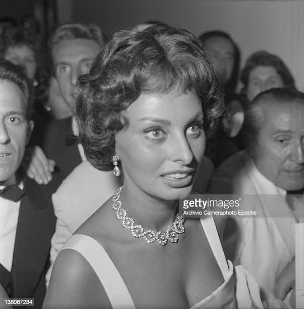 Italian actress Sophia Loren portrayed while wearing an evening dress and a prescious necklace Lido Venice 1958