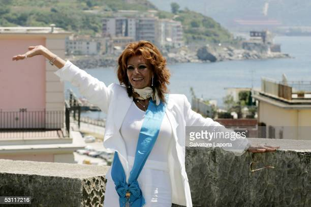 Italian actress Sophia Loren poses for photographers as she visits her home town the village of Pozzuoli to receive a Civitas Award June 22 2005 in...