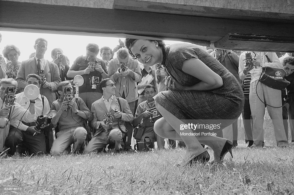 Italian actress Sophia Loren (Sofia Villani Scicolone) posing smiling portrayed by the photographers at 19th Venice International Film Festival. Venice, 1958