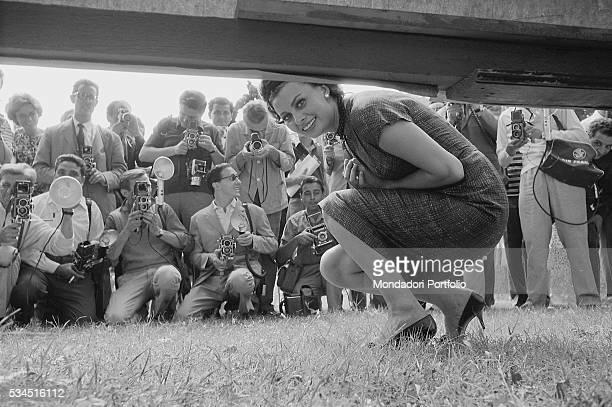 Italian actress Sophia Loren posing smiling portrayed by the photographers at 19th Venice International Film Festival Venice 1958