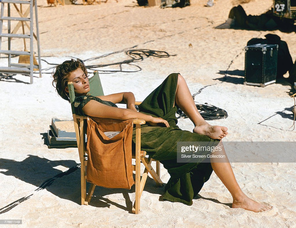 Italian actress Sophia Loren relaxes on the Libyan set of the desert adventure film 'Legend of the Lost' 1957