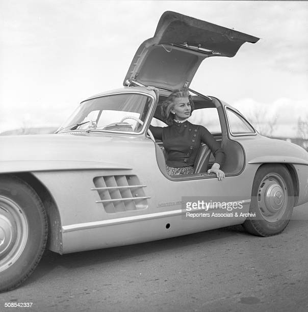 Italian actress Sophia Loren steps out from a W198 a MercedesBenz 300 SL sports car also known as Gullwing 1956
