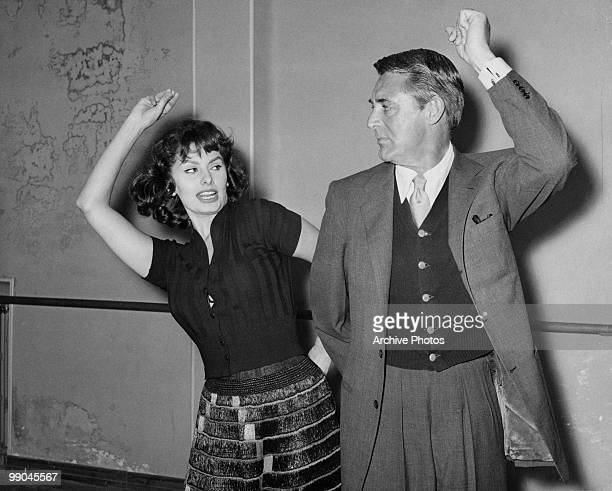 Italian actress Sophia Loren teaches costar Cary Grant to dance the Flamenco during the filming of 'The Pride and the Passion' 1957