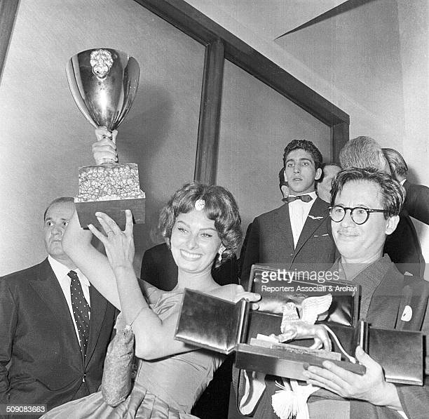Italian actress Sophia Loren winner of the Volpi Cup for Best Actress for 'The Black Orchid' and Japanese director Hiroshi Inagaki winner of the...