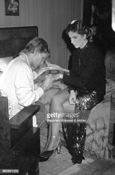 Italian actress Stefania Sandrelli having her nails polished on the set of Disobedience 1981