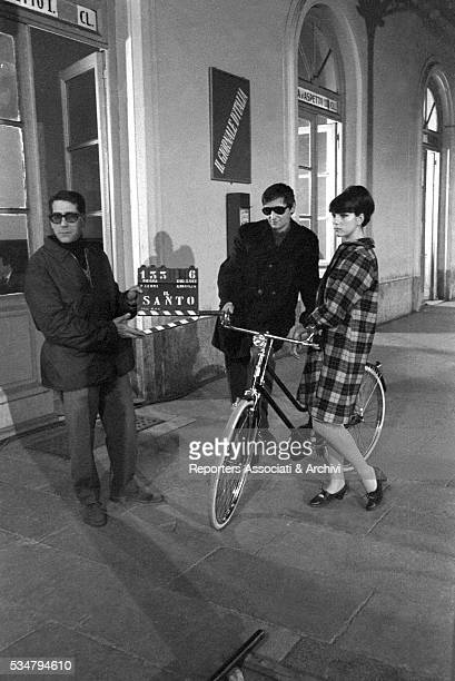 Italian actress Stefania Sandrelli leaning on a bicycle before shooting a scene on the set of the film Too Much for One Man 1967