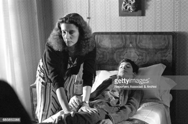 Italian actress Stefania Sandrelli touching the leg of Argentinianborn Italian actor Karl Zinny lying in bed in Disobedience 1981