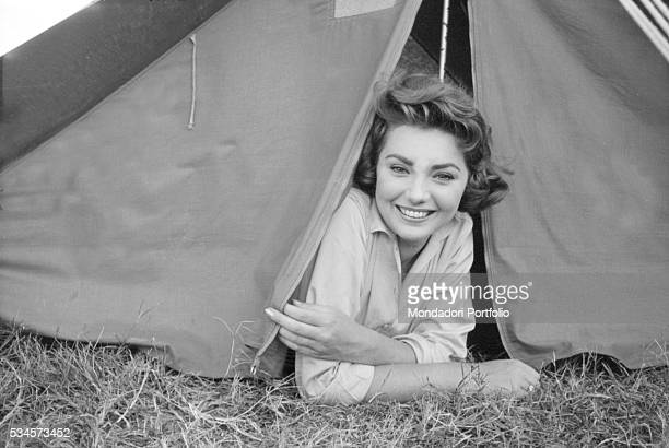 Italian actress Sylva Koscina emerging from a tent during the XVIII Venice International Film Festival Venice 1957