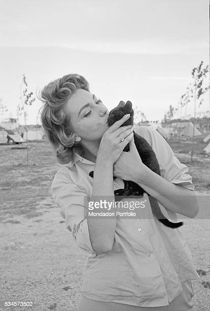 Italian actress Sylva Koscina kissing a kitten during the XVIII Venice International Film Festival Venice 1957