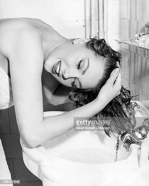 Italian actress Sylva Koscina washing her hair circa 1960