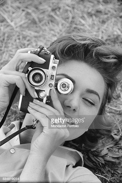 Italian actress Sylva Koscina with a camera during the XVIII Venice International Film Festival Venice 1957