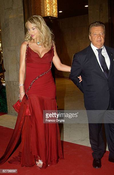 Italian actress Valeria Marini and producer Vittorio Cecchi Gori arrive at the David di Donatello Award ceremony April 29 2005 in Rome Italy