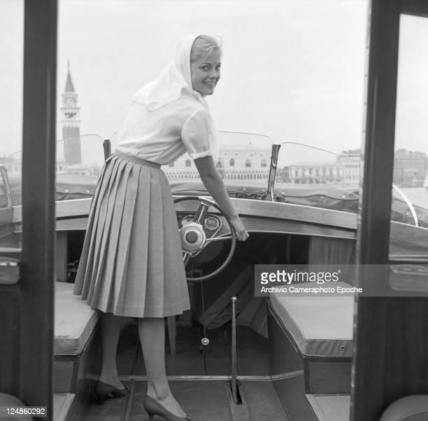 Italian actress Virna Lisi driving a water taxi venice 1959