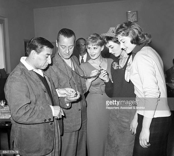 Italian actresses Elsa Martinelli Marisa Allasio and Sylva Koscina and Italian singersongwriter Renato Rascel checking some watches at the 4th Cinema...