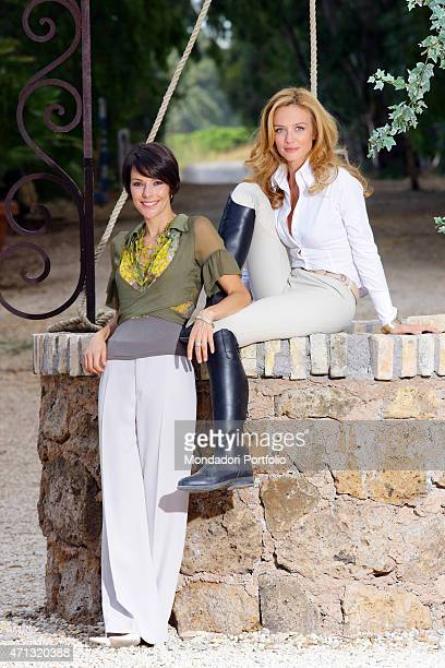 Italian actresses Francesca Cavallin and Barbara Livi posing smiling in a photo shooting on the set of the TV miniseries 'L'uomo che cavalcava nel...