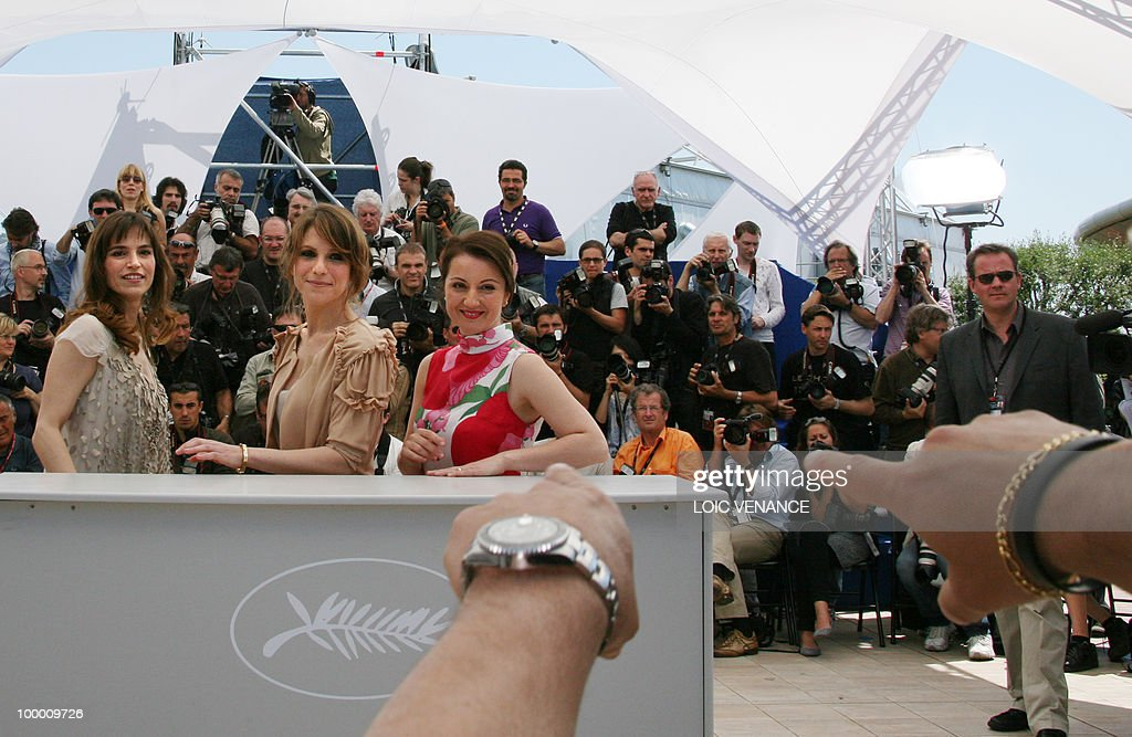 Italian actresses Isabella Ragonese (C), Stefania Montorsi and Alina Berzenteanu (R) pose during the photocall of 'La Nostra Vita' (Our Life) presented in competition at the 63rd Cannes Film Festival on May 20, 2010 in Cannes.
