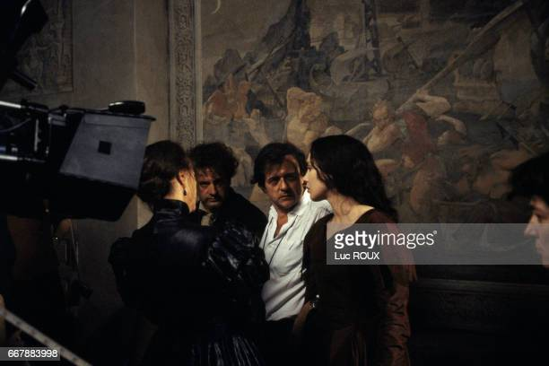 Italian actresss Virna Lisi French actor Daniel Auteuil French director Patrice Chereau French actress Isabelle Adjani on the set of La Reine Margot...