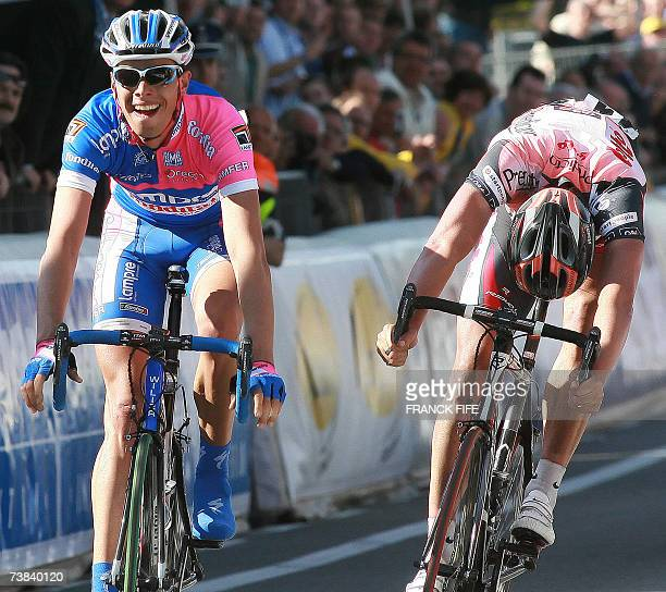 Italian Alessandro Ballan followed by Belgian Leif Hoste celebrates as he crosses the finish line of the 91st Tour of Flanders cycling race between...