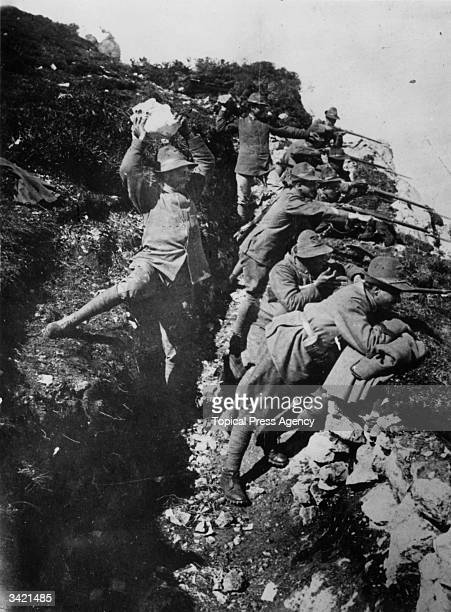 Italian alpinists defending an attack from a trench dug into the mountain during the First World War