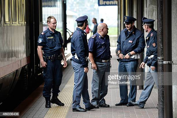 Italian and Austrian police officers stand by a train bound north to Munich at the Brenner Pass on September 3 2015 in Brennero Italy Italian police...