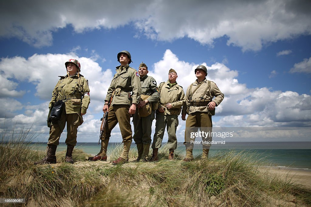 Italian and British military enthusiasts watch from Utah beach as Dakota aircraft flypast on June 4, 2014 near Saint Marie du Mont, France. Friday 6th June is the 70th anniversary of the D-Day landings which saw 156,000 troops from the allied countries including the United Kingdom and the United States join forces to launch an audacious attack on the beaches of Normandy, these assaults are credited with the eventual defeat of Nazi Germany. A series of events commemorating the 70th anniversary are planned for the week with many heads of state travelling to the famous beaches to pay their respects to those who lost their lives.