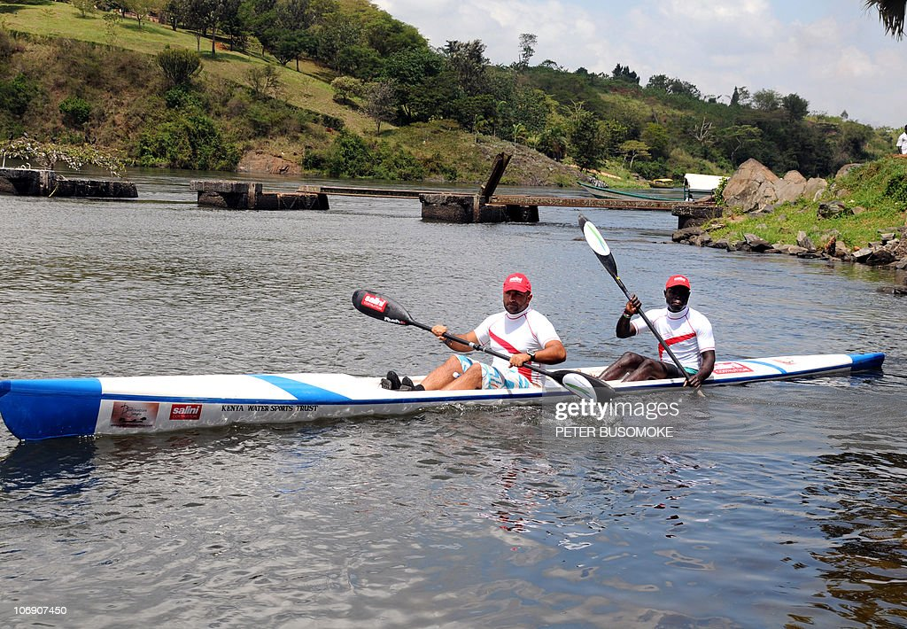 Italian and Kenyan kayakers, Francesco Gambilla (L) and Seifudin Patwa respectively, set-off from Jinja in Uganda for Kenya on November 16, 2010 in an attempt to cross Africa's largest fresh water lake, Victoria, the source of the white Nile. The Lake Victoria Kayak Expedition 2010, a campaign to promote water-sport tourism on the lake will end in Kisumu on November 21, after covering 300 kilometres over five days and nights. AFP PHOTO/Peter BUSOMOKE