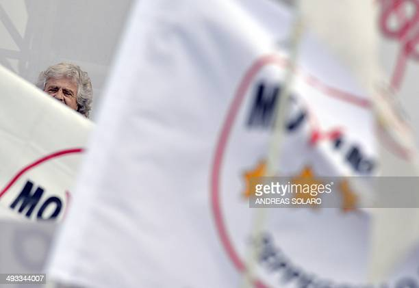 Italian antiestablishment 5Star Movement party leader Beppe Grillo gives a speech on May 23 2014 in Rome's Piazza San Giovanni where he holds a rally...