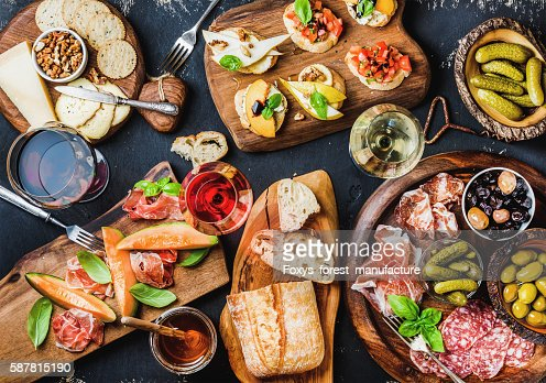 Italian antipasti wine snacks set over black grunge background : Stock Photo