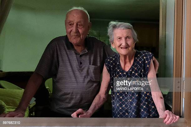 Italian Antonio Vassallo 100 yearsold and his wife Amina Fedollo pose in their house in Acciaroli southern Italy on August 23 2016 Situated on the...