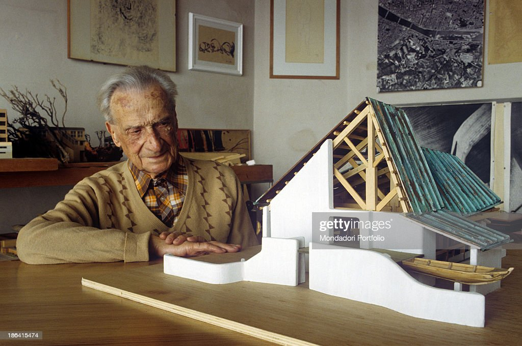 Italian architect and town planner Giovanni Michelucci observing the scale  model of the Church of Saint