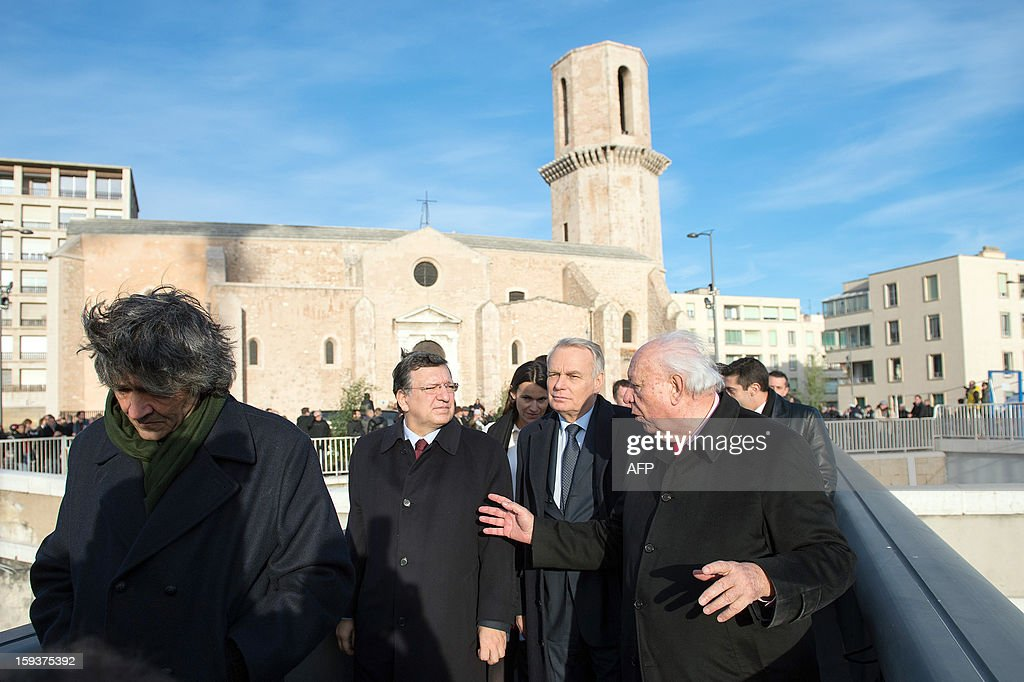 Italian architect Rudy Ricciotti, European Union (EU) Commission President Jose Manuel Barroso, France's Culture minister Aurelie Filippetti, France's Prime Minister Jean-Marc Ayrault and Marseille's Mayor Jean-Claude Gaudin arrive to visit Saint-Jean fort work site as part of the opening festivities marking Marseille as the 2013 European Capital of Culture on January 12, 2013 in Marseille, southeastern France.