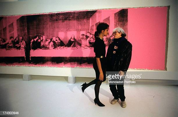 Italian art critic Gillo Dorfles attending American artist Andy Warhol 's exhibition where the painting The Last Supper is on display Milan 1986