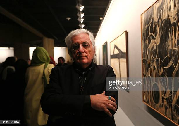 Italian art historian and curator Germano Celant poses for a picture next to a painting titled 'light in August' by Dutch American abstract...