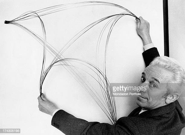 Italian artist Bruno Munar showing a metal wire multiple created by himself Milan 1968
