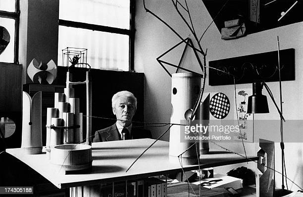 Italian artist Bruno Munari looking at one of his creations 1970s