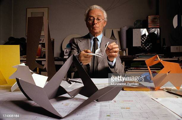 Italian artist Bruno Munari unfolding the model of a chair designed by himself 1986