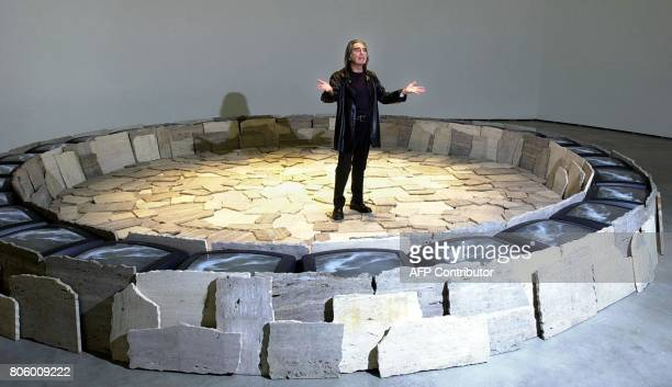 Italian artist Fabrizi Plesi gestures as he presents his work 'Roma II' at the Guggenheim museum in Bilbao 01 October 2001 The exhibition 'Selected...