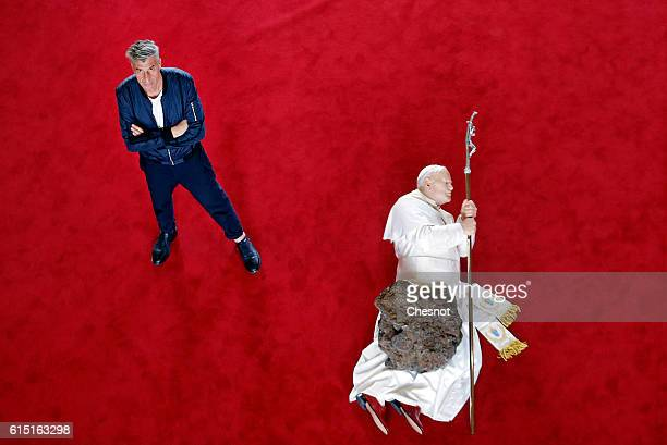 Italian artist Maurizio Cattelan poses next to his artwork 'La Nona Ora' prior to the opening of the exhibition 'Not Afraid of Love' at the Hotel de...