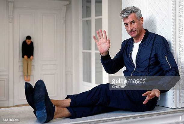 Italian artist Maurizio Cattelan poses next to his artwork 'La Rivoluzione Siamo Noi' prior to the opening of the exhibition 'Not Afraid of Love' at...