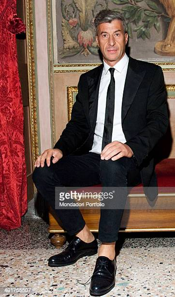 Italian artist Maurizio Cattelan posing on the opening night of his exhibition in Palazzo Reale in Milan on September 24th 2010