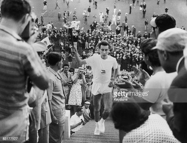 Italian athlete Giancarlo Peris brings the Olympic flame to the Olympic Stadium in Rome for the opening ceremony of the games 26th August 1960
