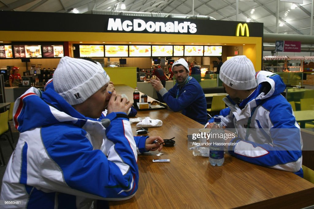 Italian athletes sit in the dining hall at the Whistler Olympic village during the media tour ahead of the Vancouver 2010 Winter Olympics on February...