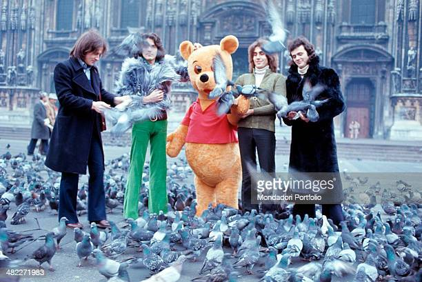 Italian band The Pooh playing with the pigeons of piazza del Duomo together with the bear Winnie the Pooh The band is formed by Italian drummer...
