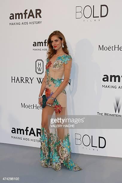 Italian blogger Chiara Ferragni poses as she arrives for the amfAR 22st Annual Cinema Against AIDS during the 68th Cannes Film Festival at Hotel du...