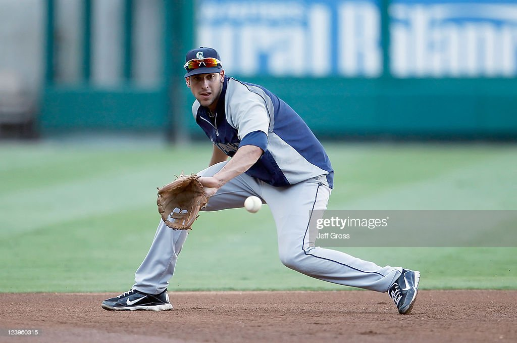 Italian born Alex Liddi of the Seattle Mariners warms up at third base prior to the start of the game against the Los Angeles Angels of Anaheim at...